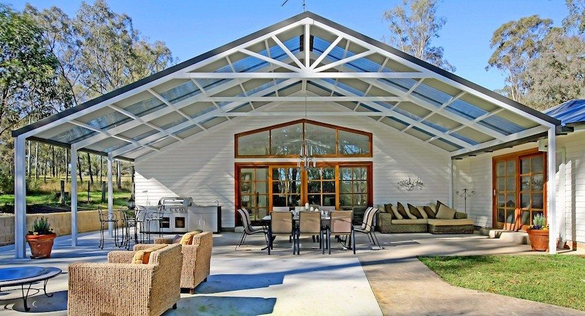 Canopy with high gable roof made of polycarbonate