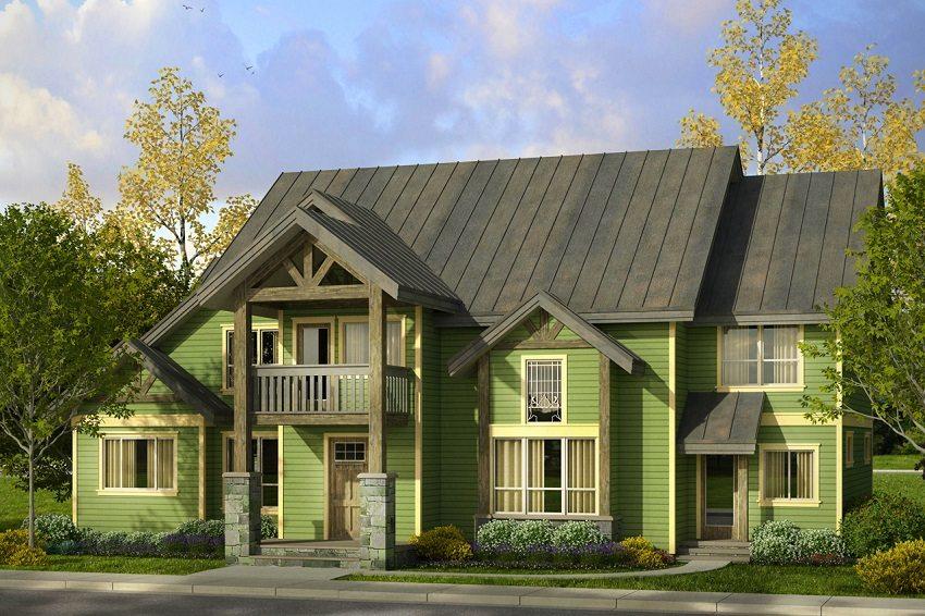 Дом обшит сайдингом сочного зеленого цвета