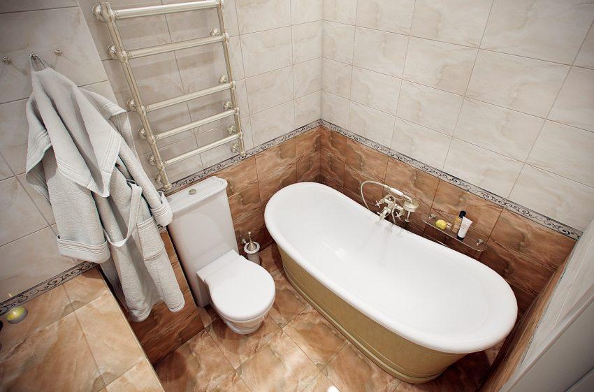 Хорошо в ванной смотрится сочетание плитки двух контрастных оттенков