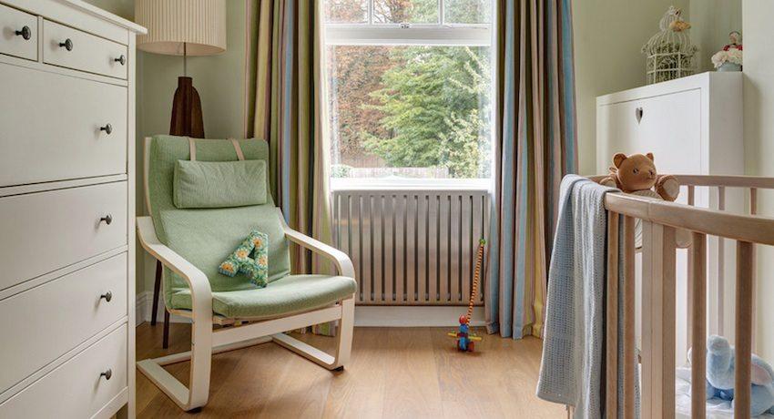 Стальной радиатор отопления в детской комнате