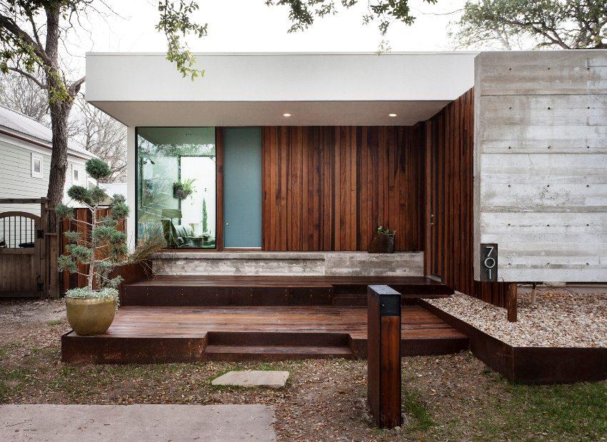 Использование натурального дерева, покрытого фасадной краской в отделке внешних стен дом