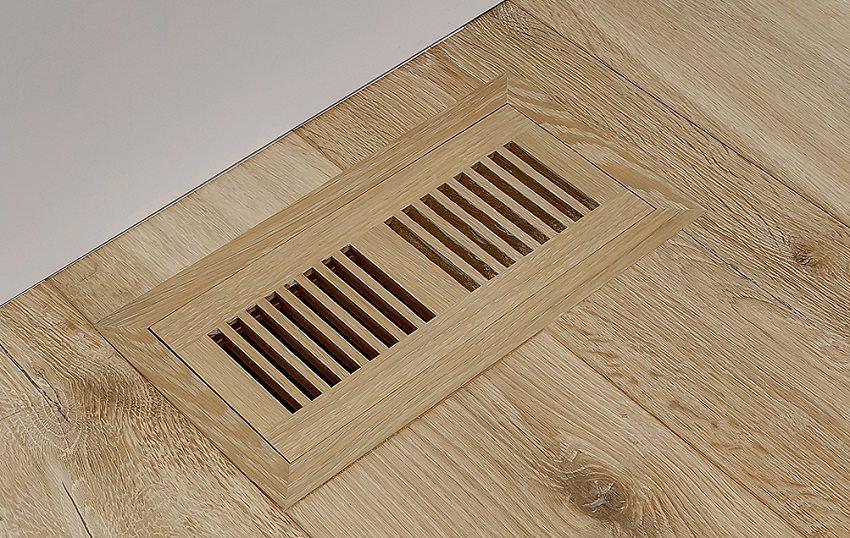 Для вентиляции подвала можно установить вентиляционные решетки в пол первого этажа