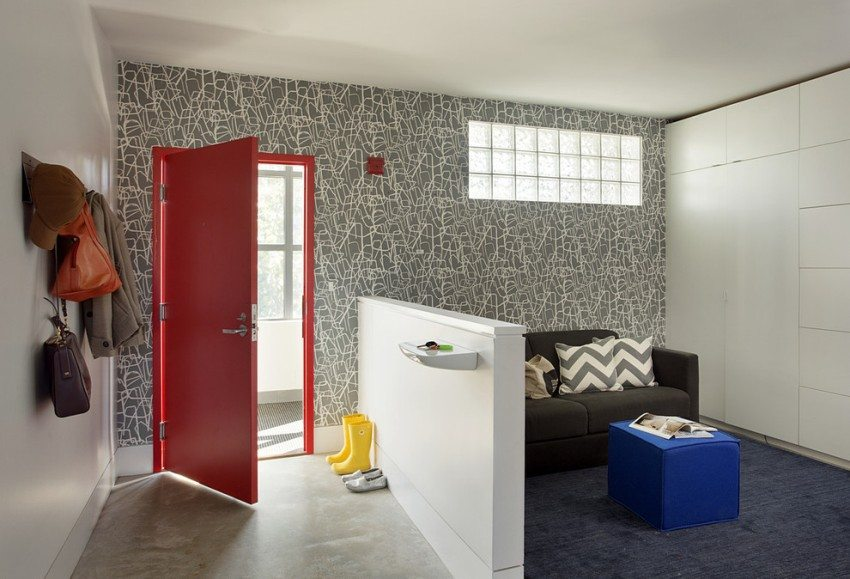 One of the walls of the hallway is covered with paper wallpaper, the rest - painted with acrylic paint