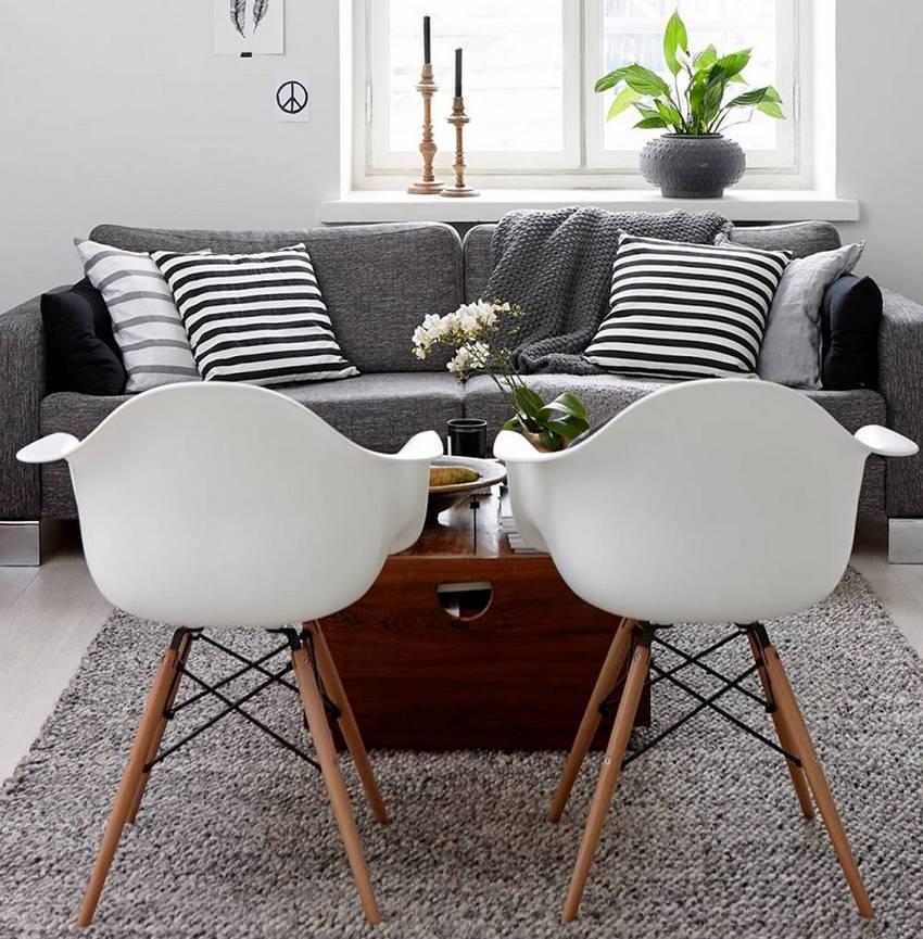 В маленькой гостиной лучше использовать функциональную мебель, не загромождающую пространство