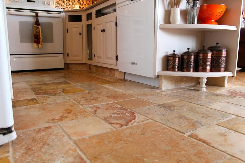 Natural stone is a durable material and is well suited for decorating the kitchen floor.