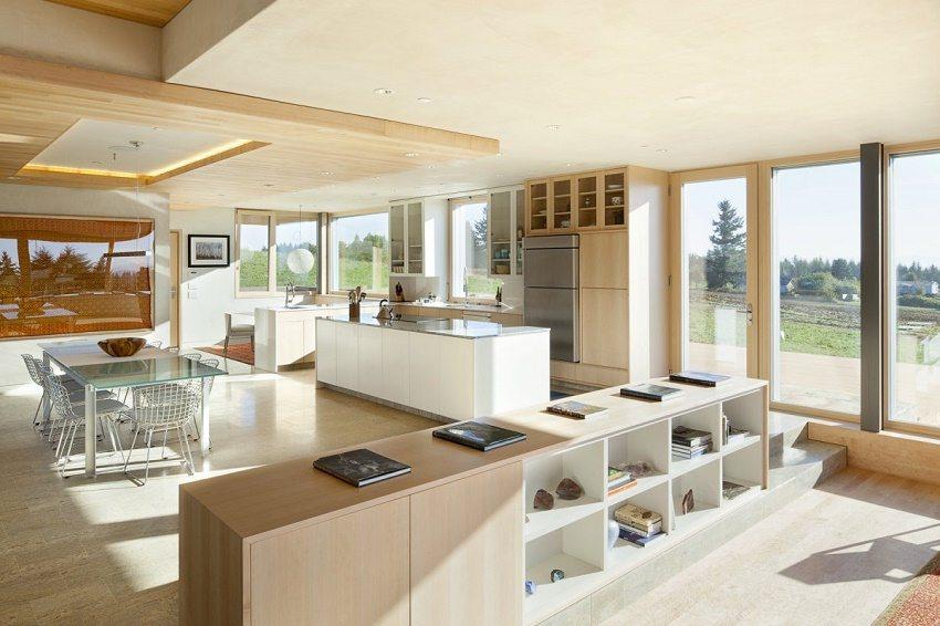Минималистская кухня-гостиная со встроенной бытовой техникой