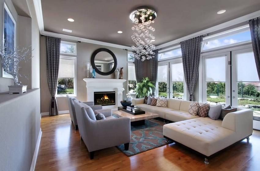 Потолок из гипсокартона отлично впишется как в классический, так и современный интерьер зала