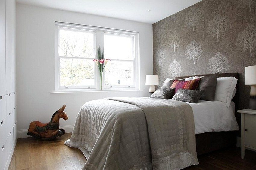 In the design of the bedroom used wallpaper two types