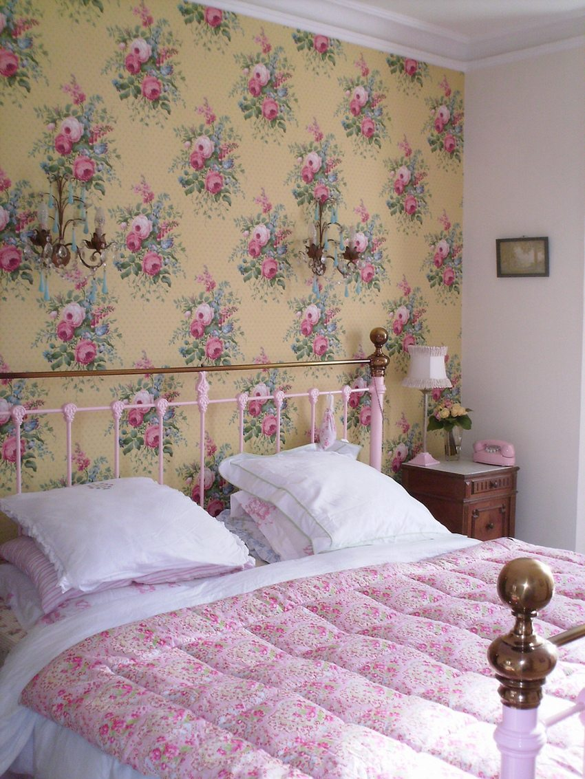 The interior of the bedroom is made in a romantic style