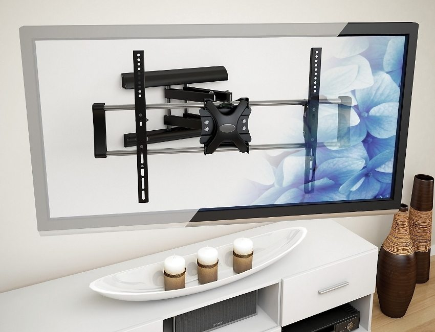 Кронштейн скрыт за панелью TV и не портит интерьер комнаты