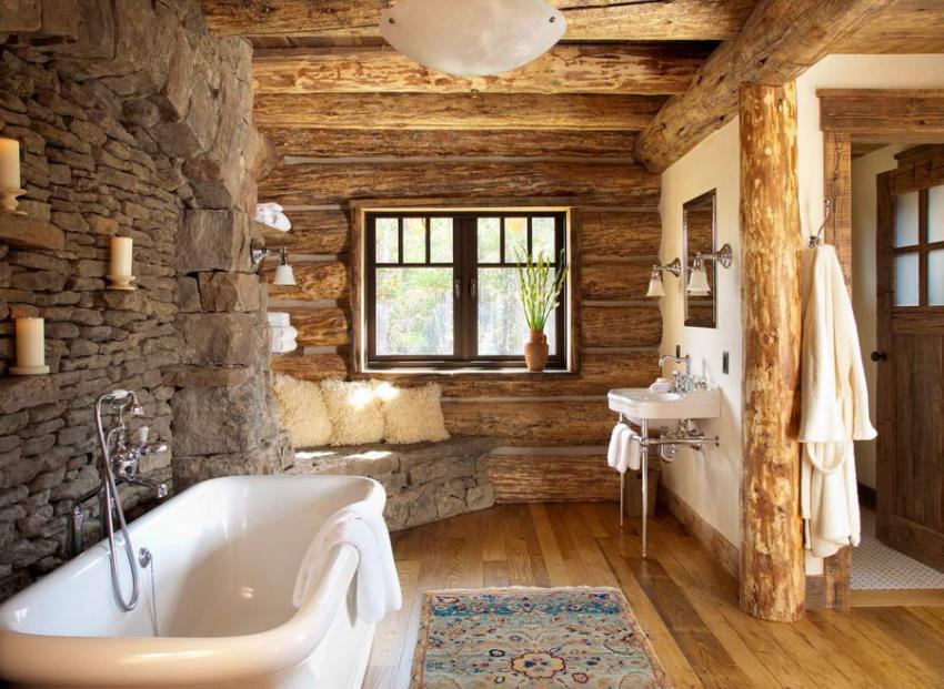 Ванная комната оформлена с применением камня и деревянного сруба