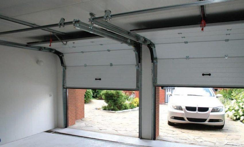 Качественные ворота для гаража должны обеспечить сохранность его содержимого, а также мобильность доступа к нему