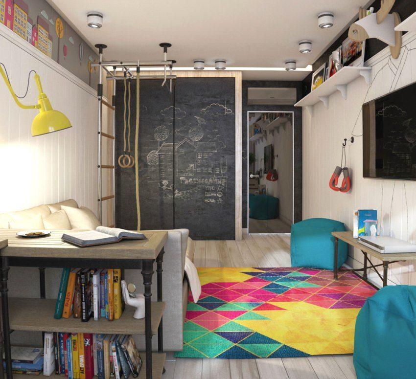 Цветной ковер и открытый стол-стеллаж зонируют комнату на две части