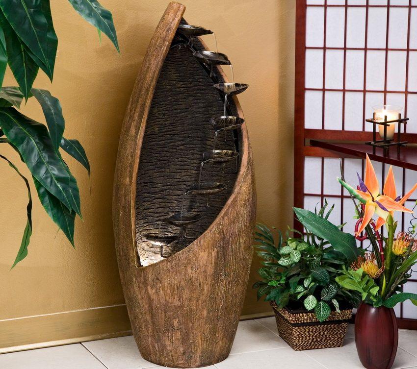 Декоративный водопад или живые растения - один из лучших способов естественного увлажнения воздуха в помещении