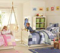 Визуальное зонирование комнаты с применением двух цветов - розового и синего