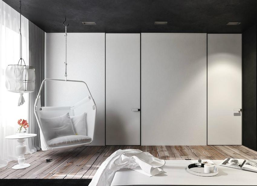 Белые фасады шкафа-стенки позволят визуально расширить пространство