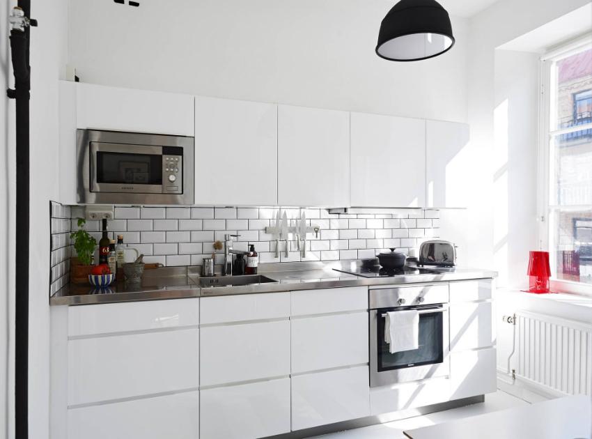 Современный скандинавский стиль оформления интерьера визуально расширяет пространство небольшой кухни