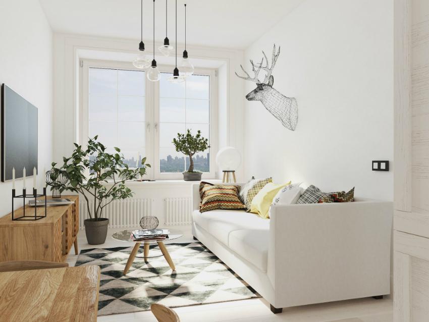 Интерьер, оформленный в однотонной, белой гамме, выглядит очень уютно за счет декора и комнатных растений