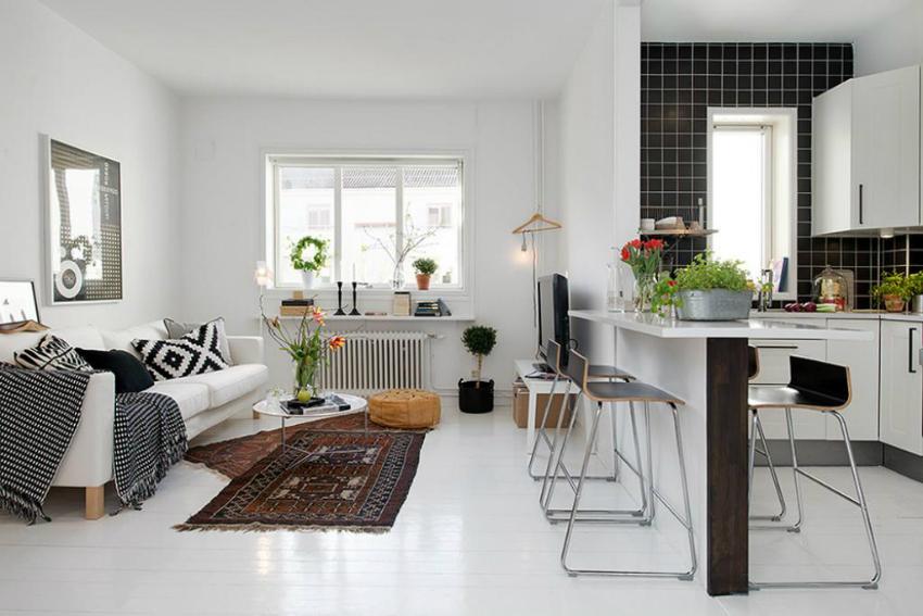 Многие владельцы современных, небольших квартир предпочитают объединять маленькую кухню с гостиной
