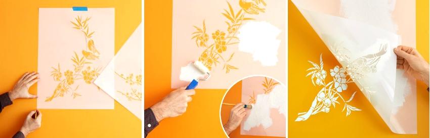 Процесс нанесения рисунка на окрашенную стену с помощью пластикового трафарета