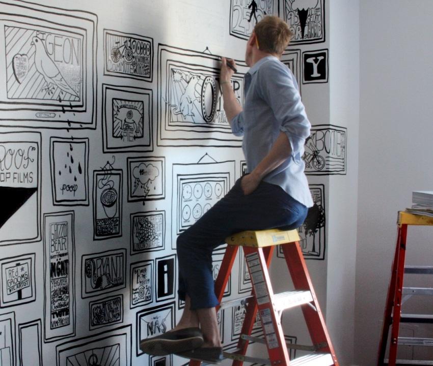 Оригинальный рисунок на стене в виде картин в рамах