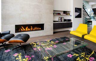 Камин в интерьере гостиной: фото традиционных и современных моделей