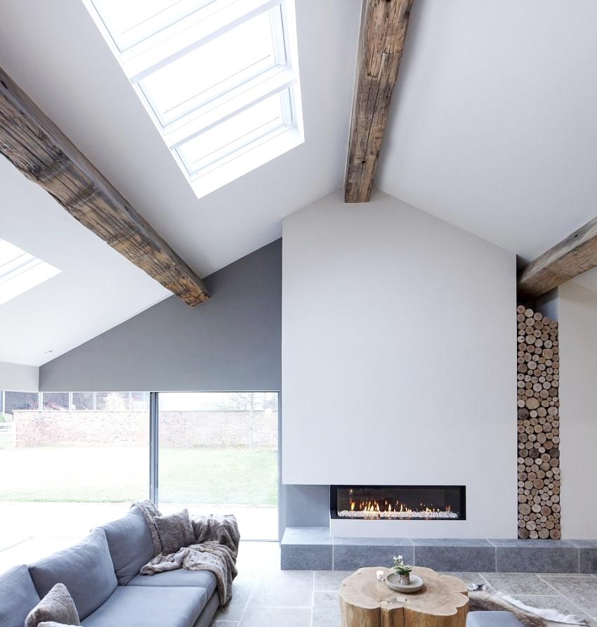 Пример использования камина в качестве ключевого акцента в комнате, оформленной в стиле модерн
