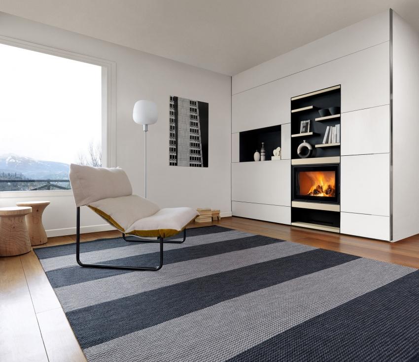Встраиваемый камин можно разместить в нише из гиспокартона или мебельном гарнитуре