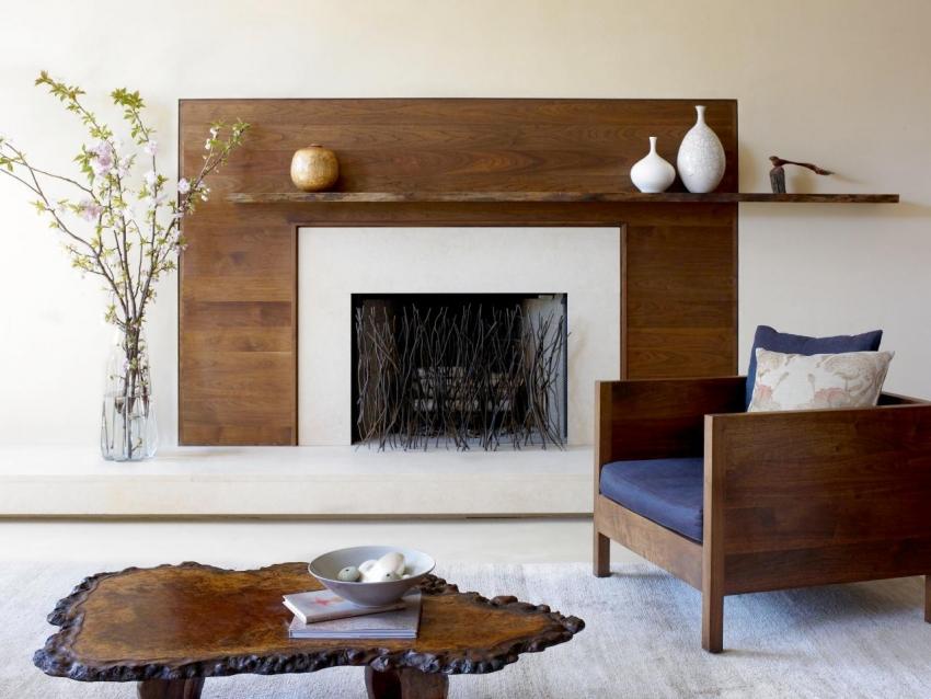 Стиль оформления камина должен гармонировать с другими деталями интерьера комнаты