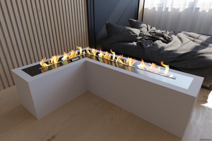 Для оформления спальни в сдержанном стиле можно использовать современный биокамин