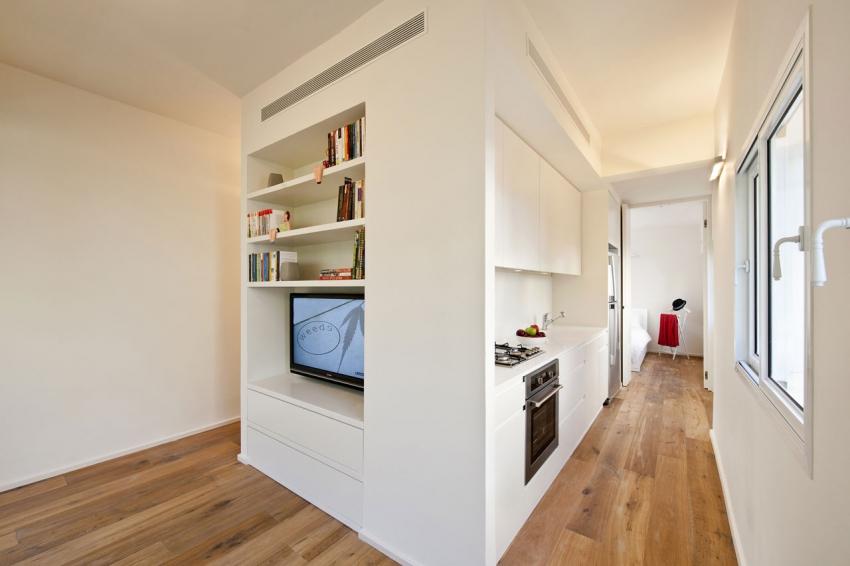 С помощью гипсокартонных конструкций можно грамотно разделить и зонировать квартиру со свободной планировкой