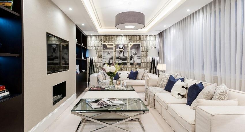 С помощью подвесной светодиодной люстры можно создать элегантный и в то же время простой интерьер для современной гостиной