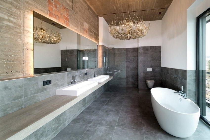 Белая акриловая ванна гармонично смотрится в современно оформленном интерьере ванной комнаты