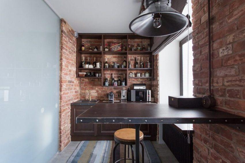 Распространенный прием увеличения площади кухни - частичтный демонтаж перегородки в гостиной