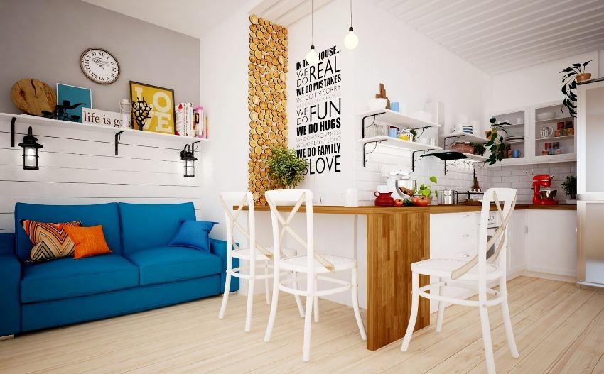 Объединив кухню с гостиной, можно получить огромную комнату-студию, которую нужно поделить на зоны