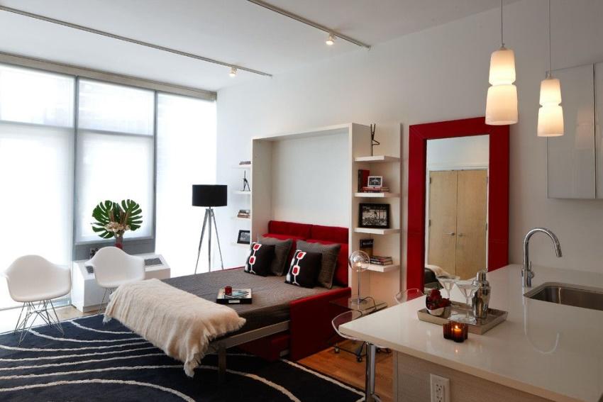 Оптимальное решение для однокомнатной квартиры — встроенная мебель, которая легко трансформируется и занимает меньше места