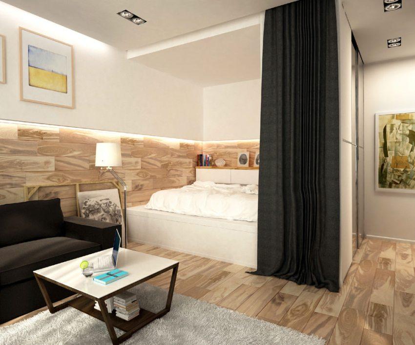 Подиум способен не только обозначить зону комнаты, но также в нем можно разместить выдвижные ящики для одежды, экономя при этом пространство
