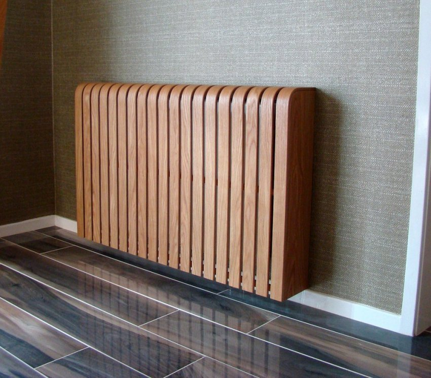 Свою декоративную функцию лучше всего могут реализовать деревянные защитные экраны для радиаторов отопления