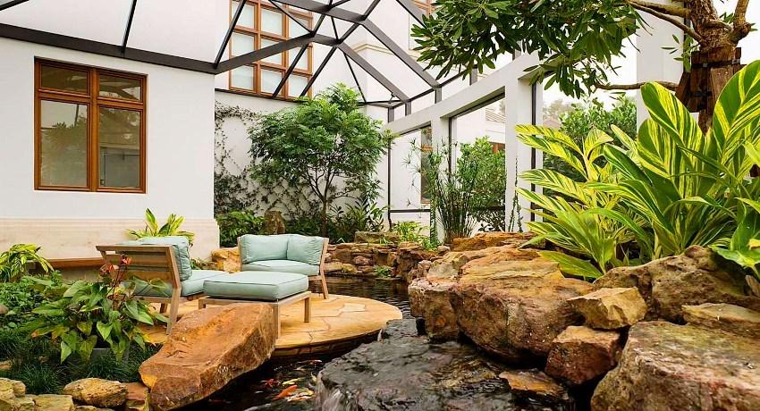Зимний сад в частном доме — особый уголок, где размещаются различные комнатные растения, создавая особую атмосферу