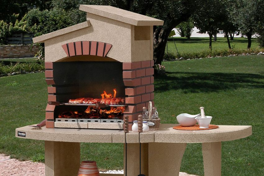 A comfortable brazier made of bricks with a roof and an additional table