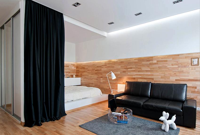 Есть много способов разделить комнату на зоны, например, повесить длинную штору