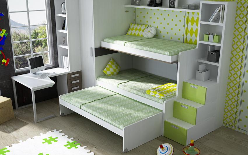 Выдвижная кровать-трансформер в детской комнате позволяет решить вопрос размещения нескольких спальных мест