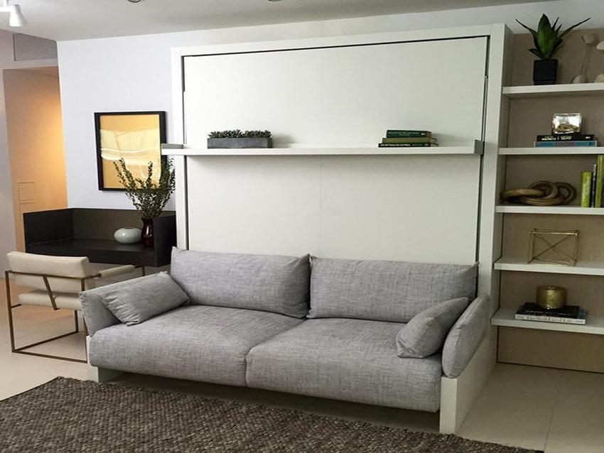 Диван трансформирующийся в кровать - одна из наиболее популярных модификаций для однокомнатных квартир