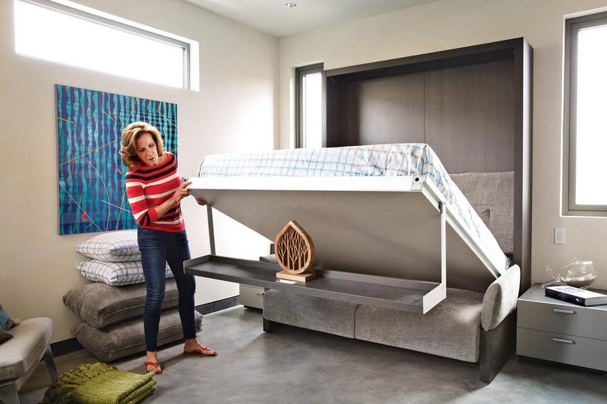 Встроенная кровать трансформер очень удобна в использовании так как ее легко складывать и раскладывать