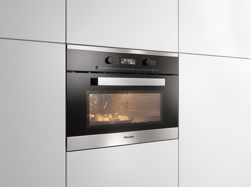 Владельцам квартир с миниатюрными кухнями придется по душе компактный электрический духовой шкаф, имеющий меньшую ширину и высоту, чем привычные аналогичные устройства