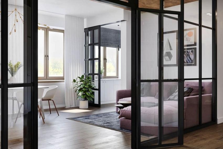 Стеклянная дверь выполняет функцию разделения пространства при этом визуально создавая ощущение простора и легкости
