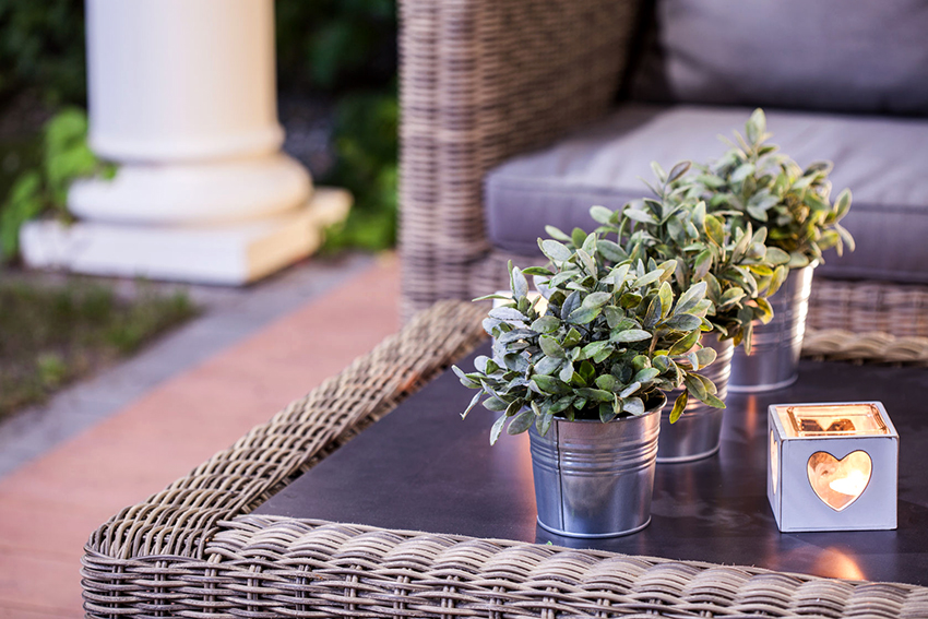 On the terrace or in the gazebo you can put a stylish coffee table from rattan
