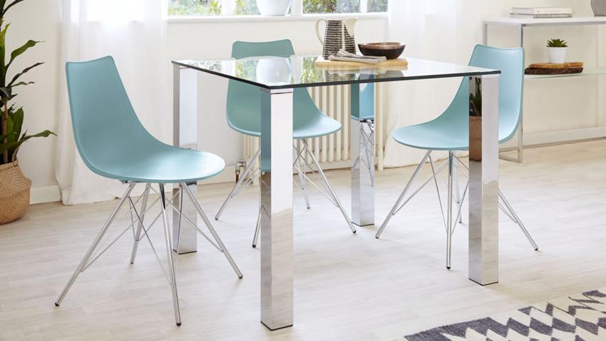 В сочетании с ножками из хромированной стали стеклянный стол прекрасно впишется в интерьер с лаконичным дизайном