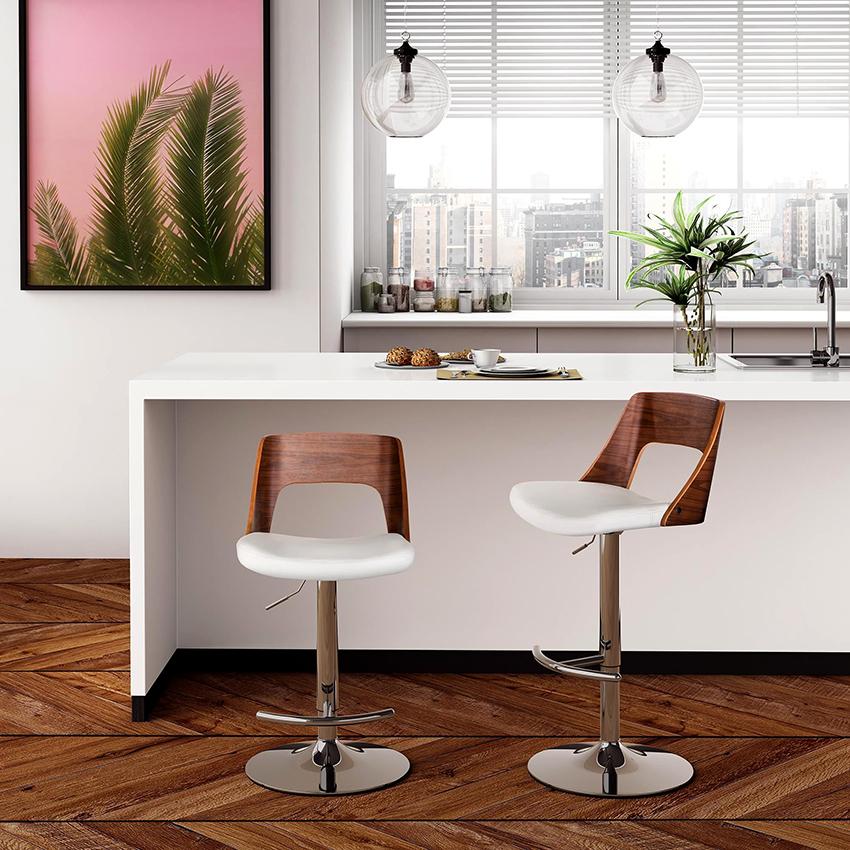 Барные столы компактны и с их помощью можно зонировать пространство кухни