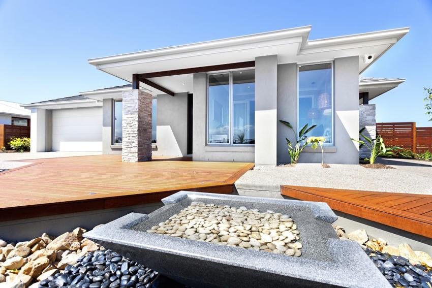 Часто натуральный камень применяется для декоративной отделки фасада дома в стиле модерн